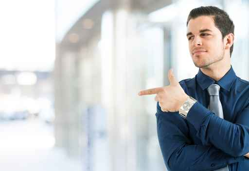 Businessman pointing his finger to the copy-space